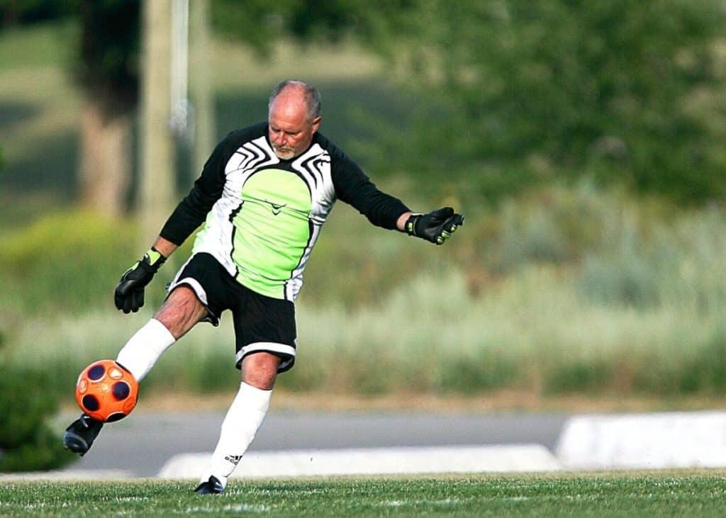 goalkeeper kicking a ball