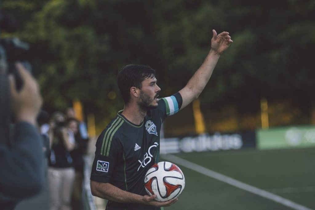 player about to throw soccer ball