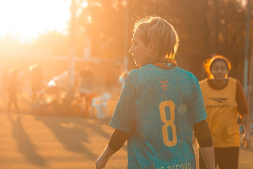 a woman soccer player in sunlight