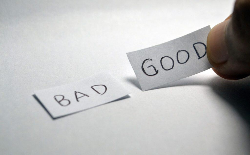 two pieces of paper - one says good one says bad