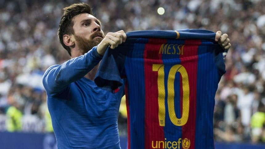lionel Messi holding up number 10 jersey