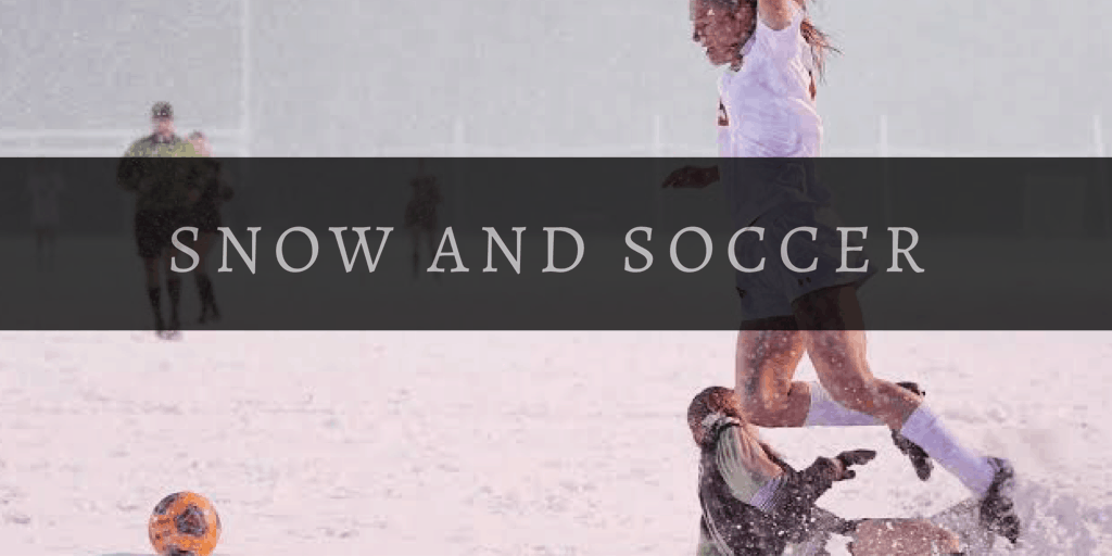 female soccer player in snow