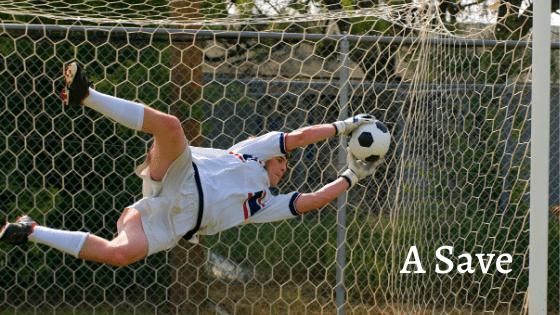 goalkeeper saving a shot at goal