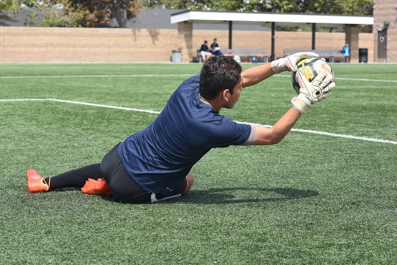 Soccer goalie in control of ball
