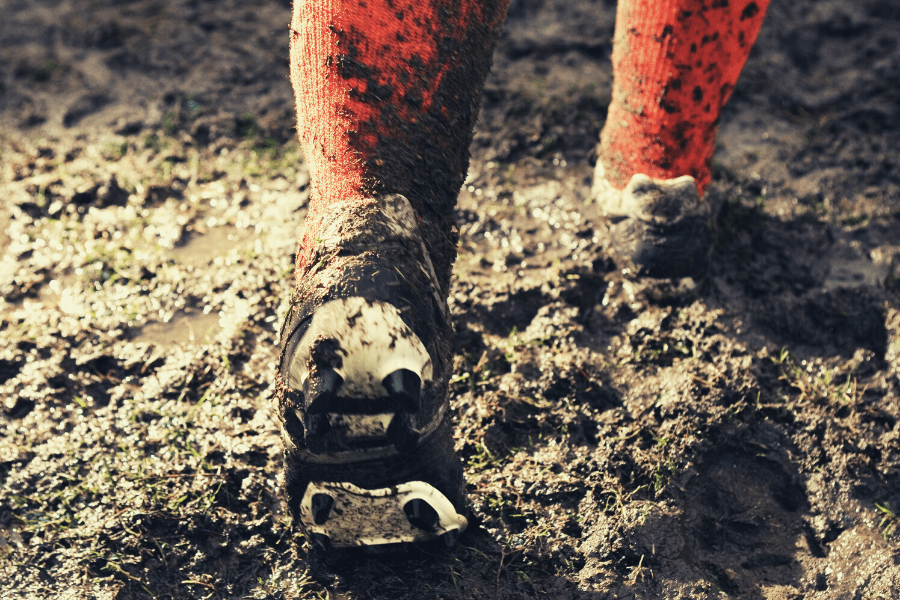 Soccer cleats in mud