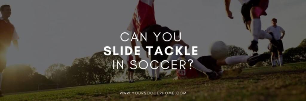 soccer player making a slide tackle