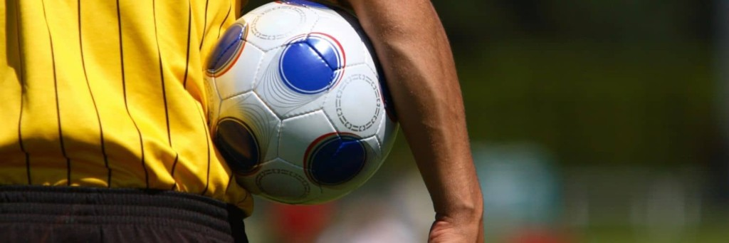 image of soccer referee holding ball