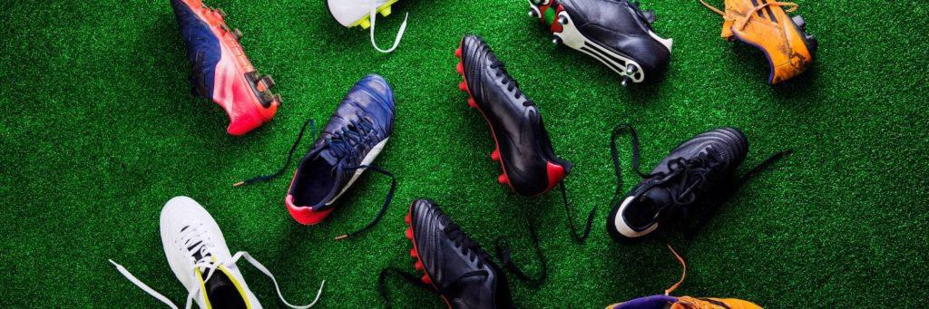 Soccer cleats laid on grass