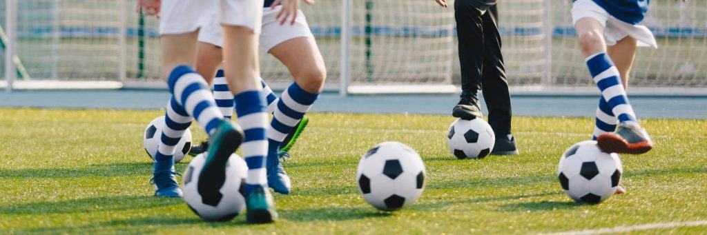 Soccer  players dribbling ball