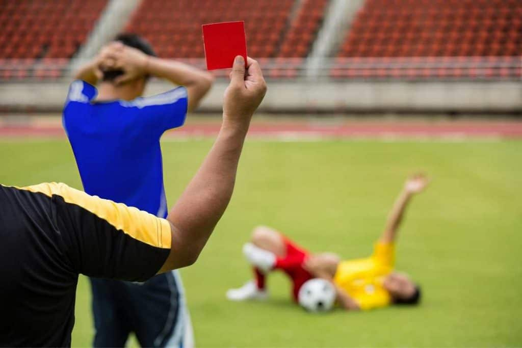 Soccer player with hand up after foul