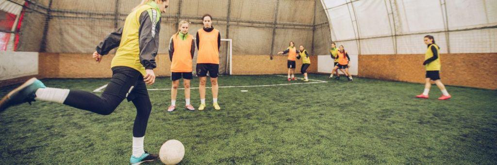 soccer player taking free kick